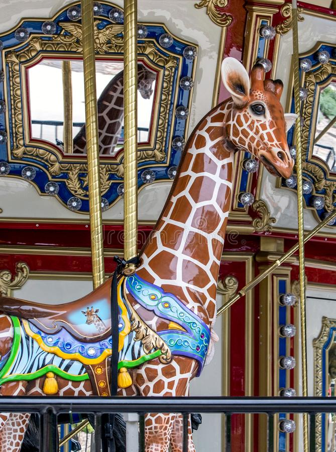 Beautiful carved giraffe on a vintage carousal royalty free stock image