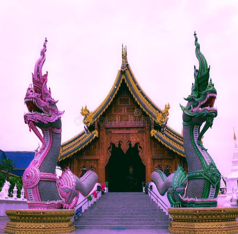 The beautiful carved wood chapel,Chiangmai,Thailand. stock photo