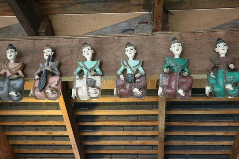 Beautiful carved wooden dolls. Beautiful carved wooden dolls, old art royalty free stock photo