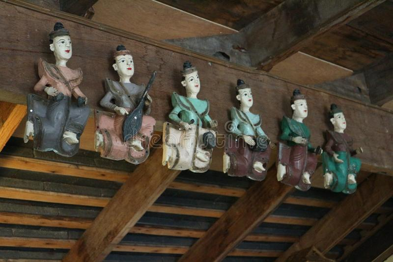 Beautiful carved wooden dolls. Beautiful carved wooden dolls, old art royalty free stock photos