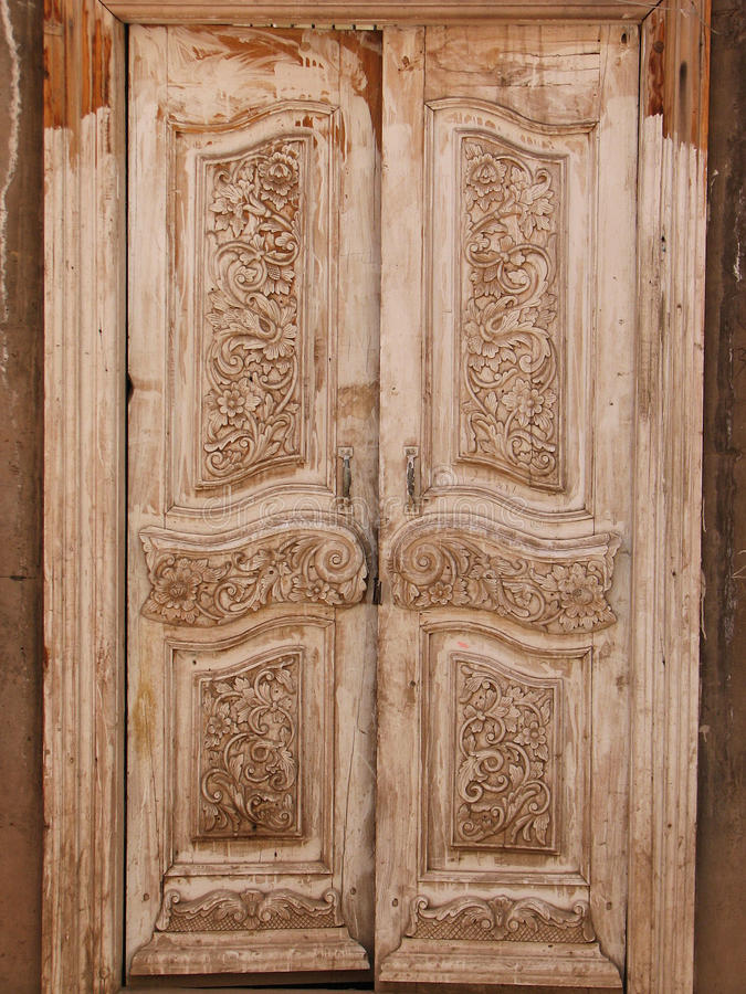 Beautiful carved wooden doors royalty free stock image