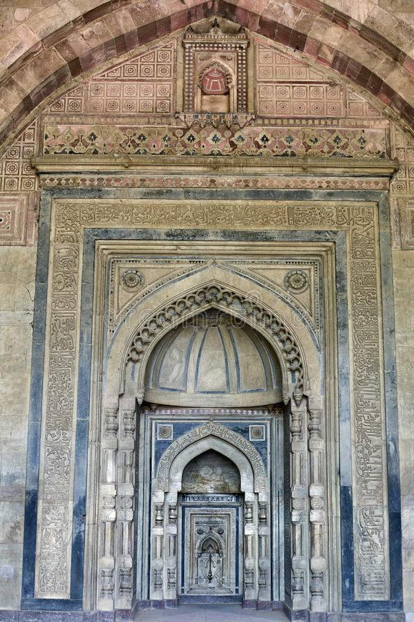Beautiful carving on White Marble Mihrabs Prayer Niches inside Purana QilaOld Fort DELHI. 12-jun-2004-Beautiful carving on White Marble Mihrabs Prayer Niches stock photography