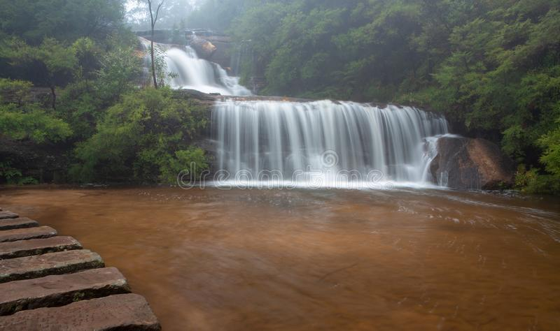 Waterfall in BLue Mountains with stepping stones royalty free stock photos