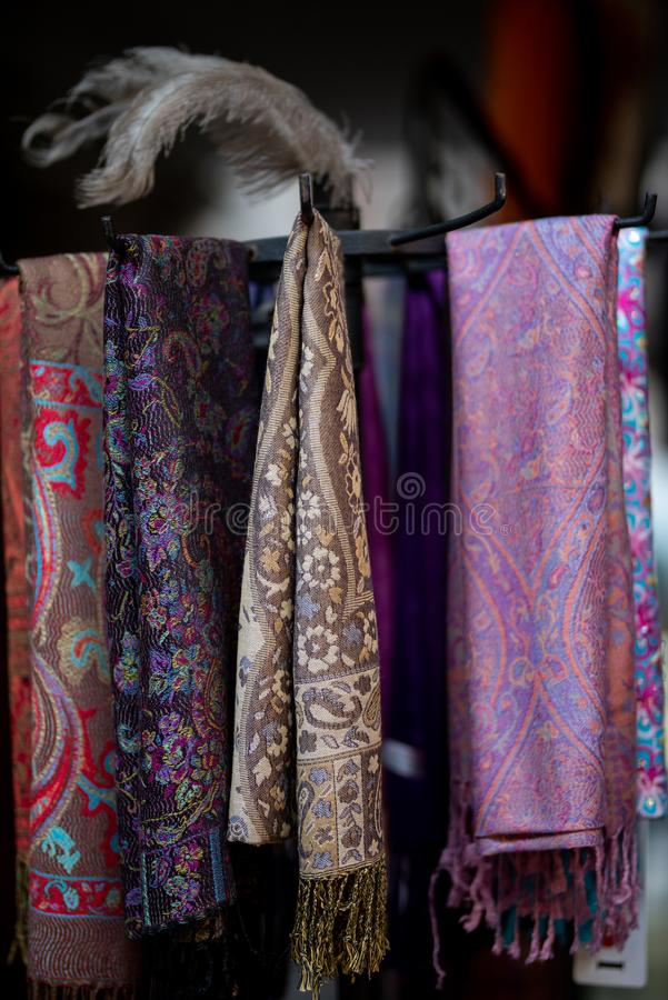 Beautiful cashmere scarves hanging in a bazaar in Jerusalem royalty free stock photos