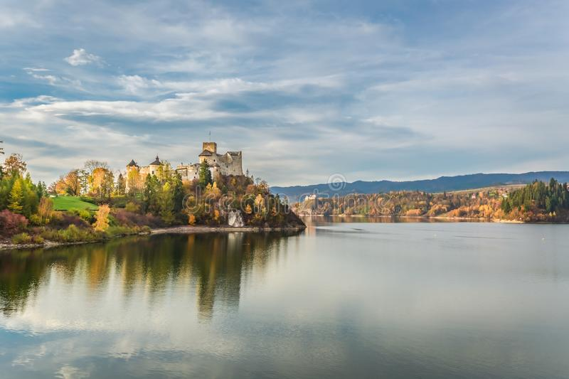 Beautiful castle by the lake at sunset in autumn, Poland. Europe stock image