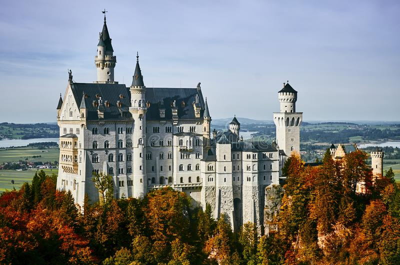 Beautiful castle Neuschwanstein in autumn sunny day royalty free stock image