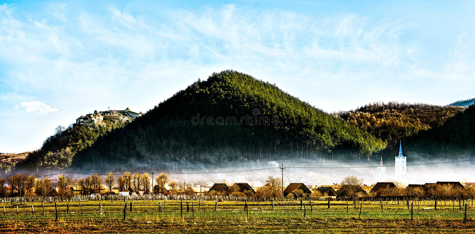 Download Beautiful Castle On A Peak Over A Town And A Cemetry Under The Blue Sky Stock Photo - Image: 30837094