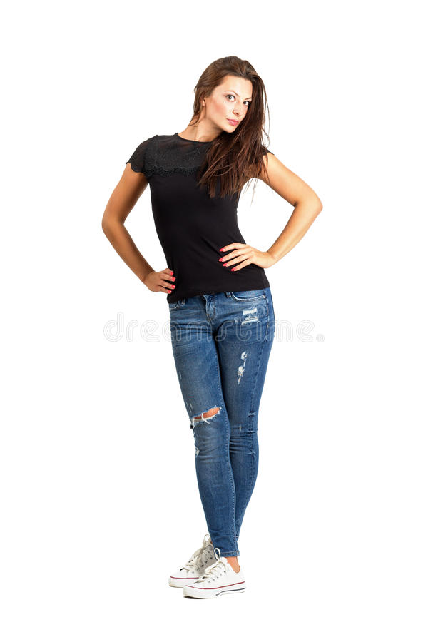 Beautiful casual woman with arms on her hips akimbo posing royalty free stock image