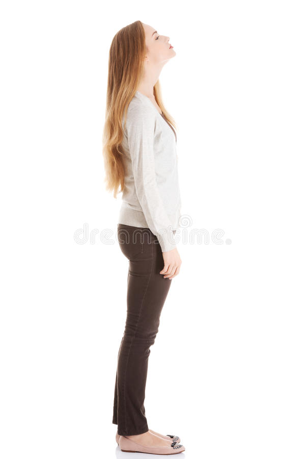 Beautiful casual woman is looking up. Side view. royalty free stock photo