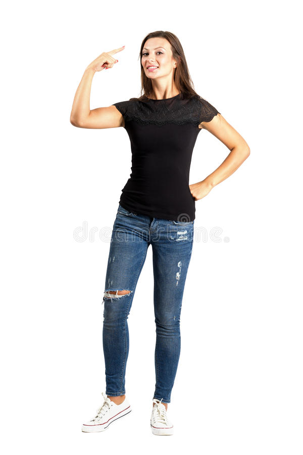 Beautiful casual woman making crazy hand gesture. royalty free stock photo