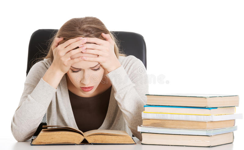 Beautiful casual woman student worried, scared is sitting by a d stock photography