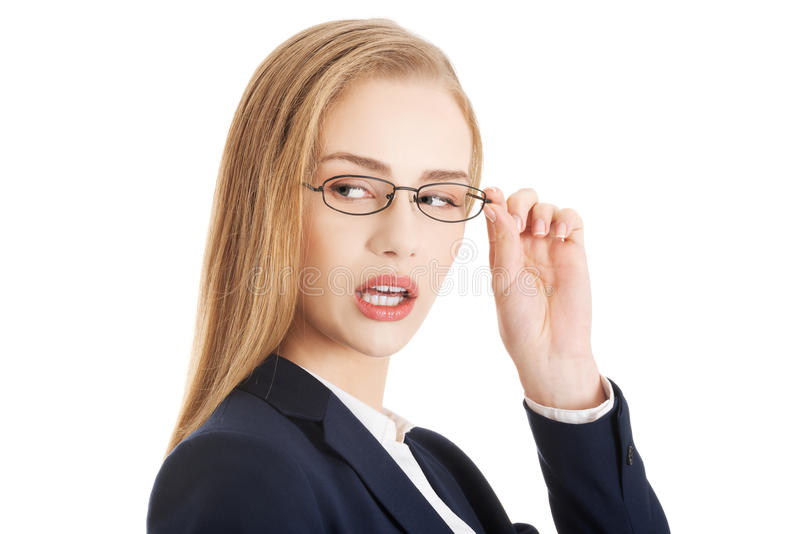 Beautiful caucasian business woman in eyeglasses is looking asid royalty free stock photo