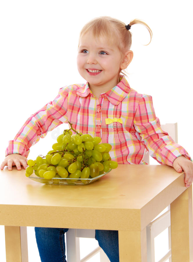Free Beautiful Caucasian Girl Eating Grapes Sitting At Stock Photo - 50420960