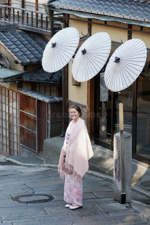 Caucasian girl wearing a traditional Japanese kimono stock photos