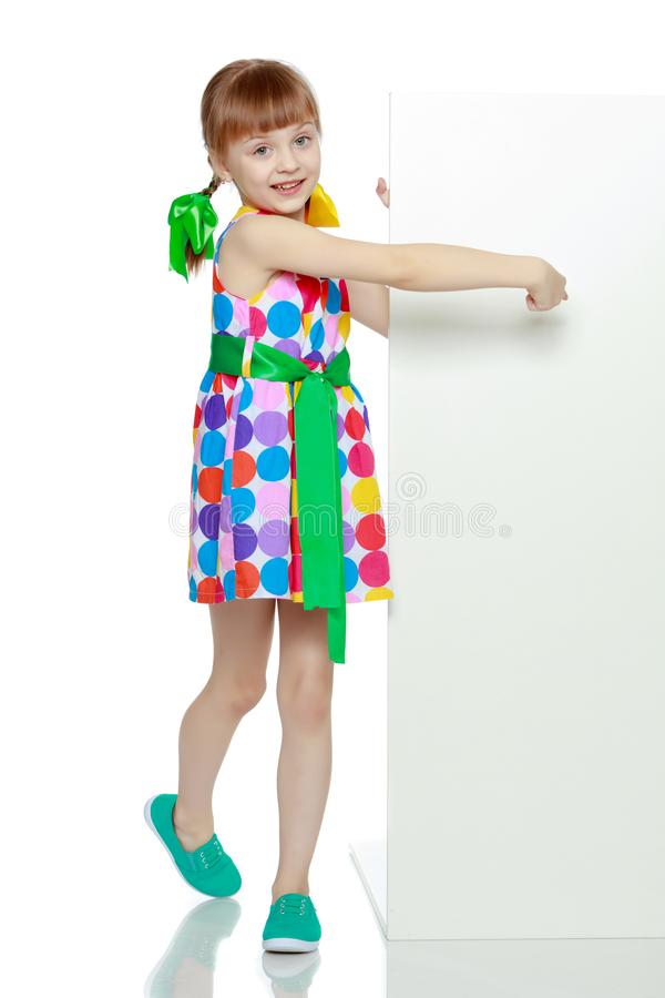 Girls looks because of the white obstacle. stock photo