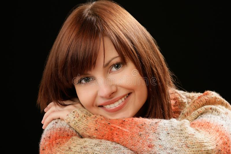 Beautiful Caucasian smiling young female model with red hair stock photo