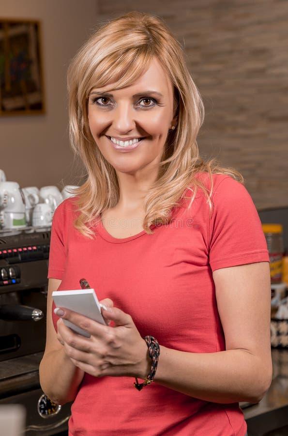 Beautiful caucasian waitress stock photo