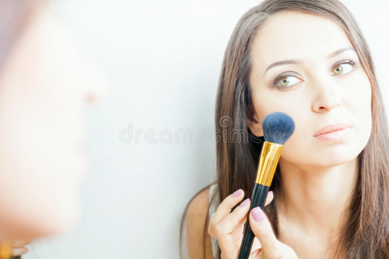 Beautiful caucasian woman or makeup artist doing make up yourself download beautiful caucasian woman or makeup artist doing make up yourself stock photo image of solutioingenieria Image collections