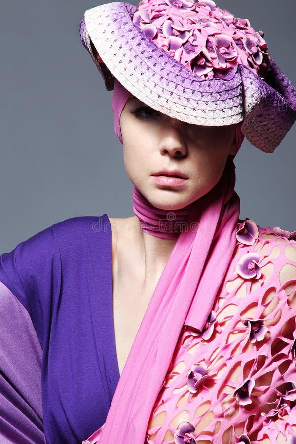Beautiful caucasian woman in pink elegant dress royalty free stock photo