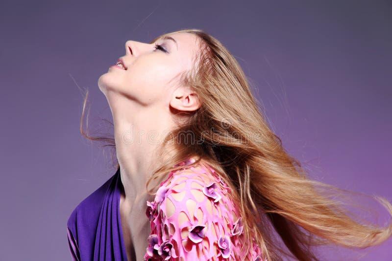 Beautiful caucasian woman in pink elegant dress royalty free stock photography