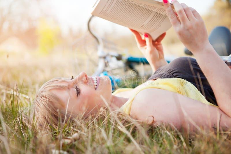 Beautiful Caucasian woman reading outdoor royalty free stock image