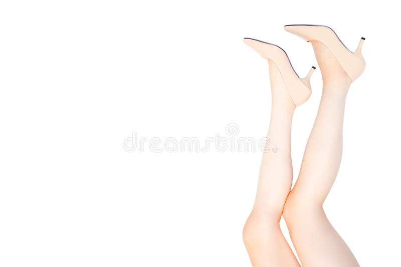 Beautiful Caucasian Woman Legs Wearing Beige Medium High-Heels Shoes on White Color. Fashion Accessory Shoe Selfie. Female stock images