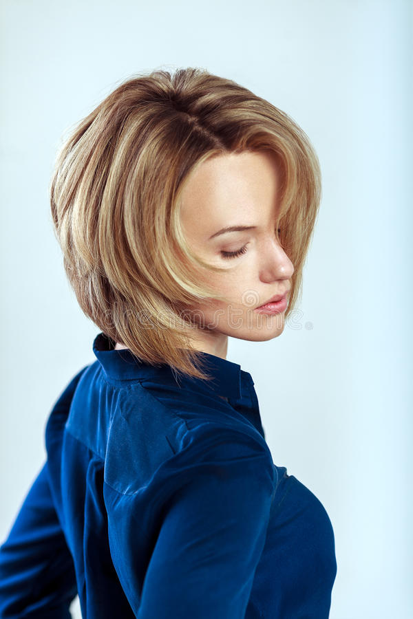 Beautiful caucasian woman with short blond hair royalty free stock images