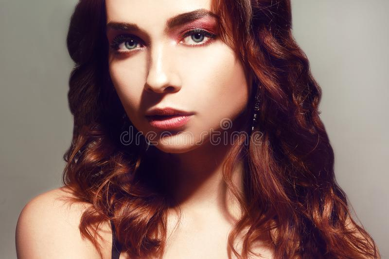 Beautiful caucasian woman with short brown curly hair. Portrait of a pretty young adult girl. face of an attractive lady posi stock photos