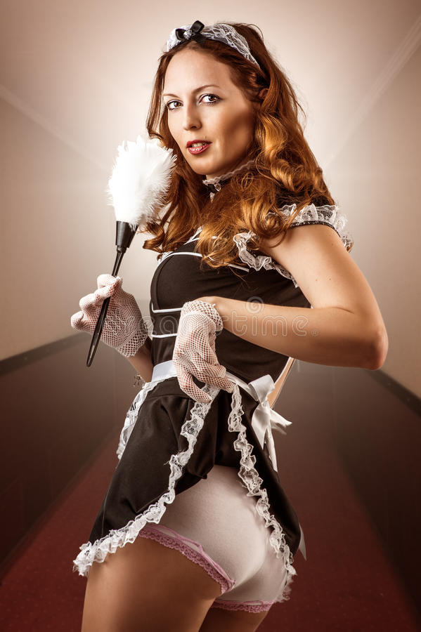 French Maid holding duster royalty free stock photos