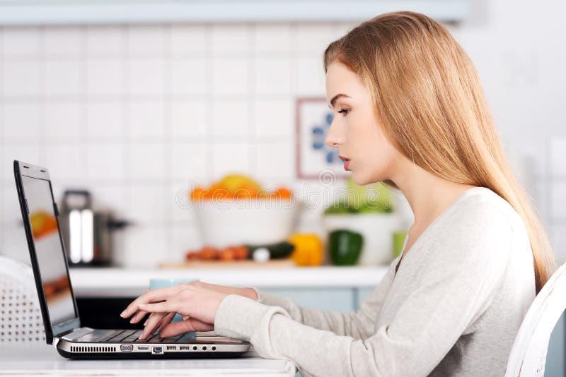 Beautiful caucasian woman working on laptop. stock photos