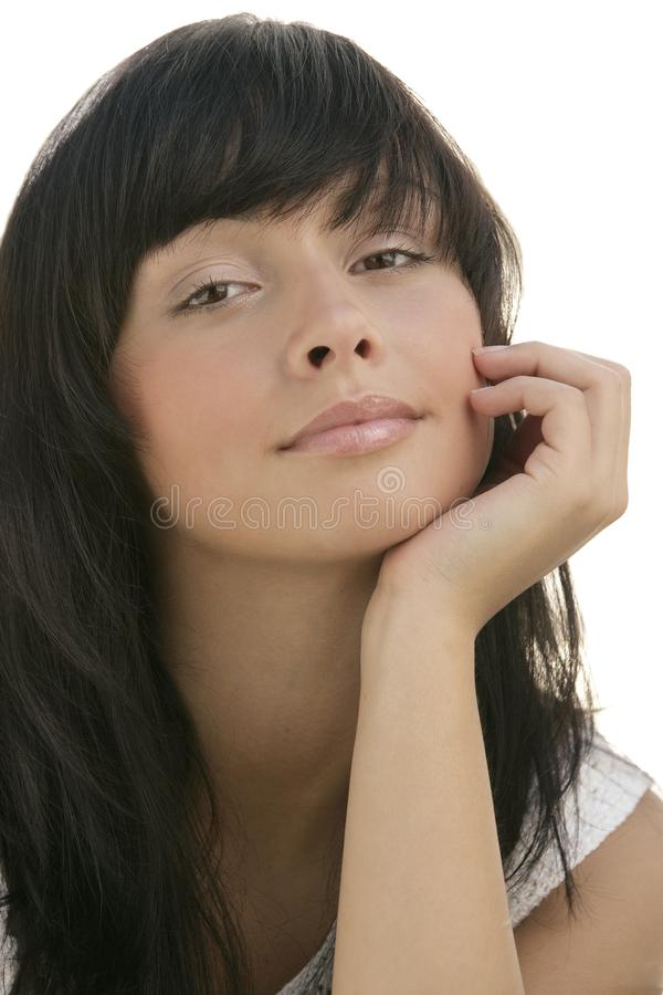 Beautiful Caucasian young female model with long dark hair resting chin on her hand royalty free stock photography