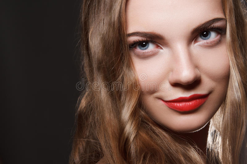 Beautiful caucasian young woman with red lips make stock image