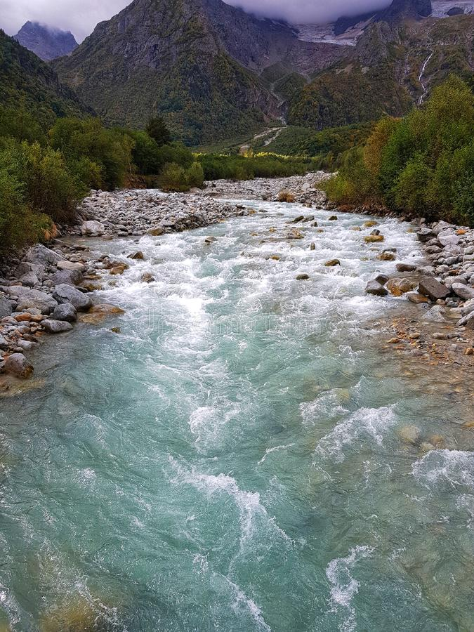 Water river and mountains. Amazing forest, rock river, and mountain summer beautiful caucasus harsh mountains water royalty free stock photography
