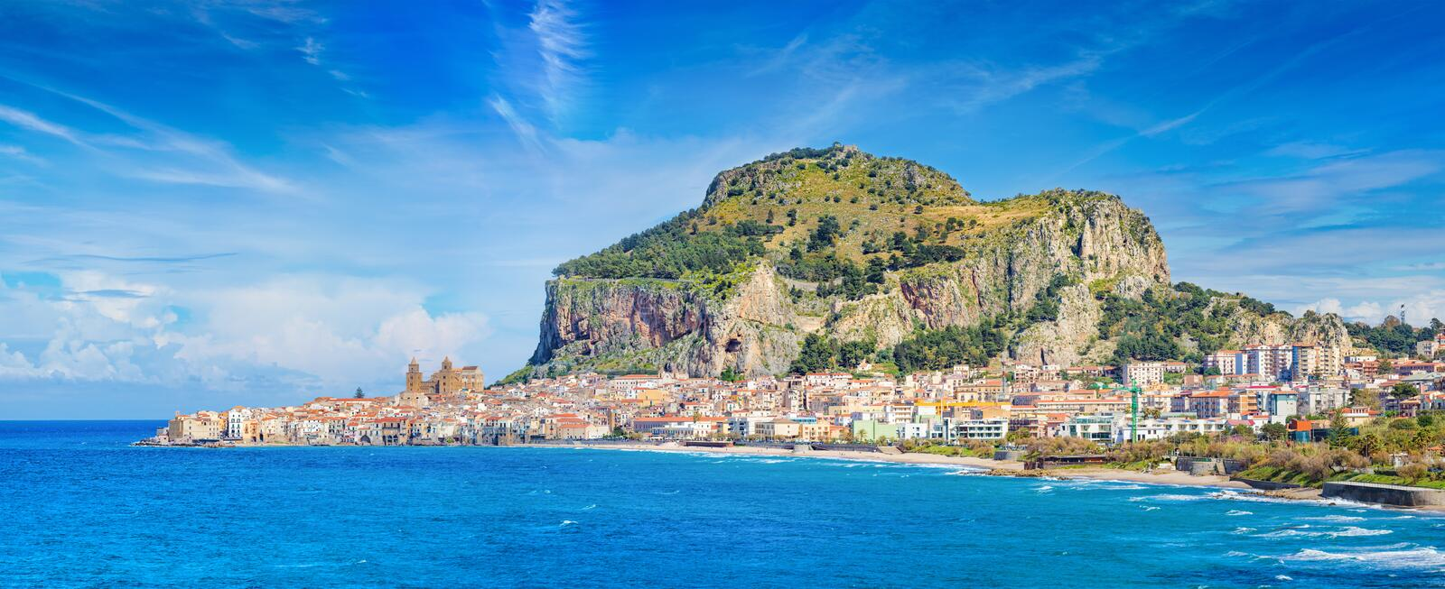 Beautiful Cefalu, small resort town on Tyrrhenian coast of Sicily, Italy. Long sandy beach and blue sea in Cefalu, town in Italian Metropolitan City of Palermo royalty free stock images