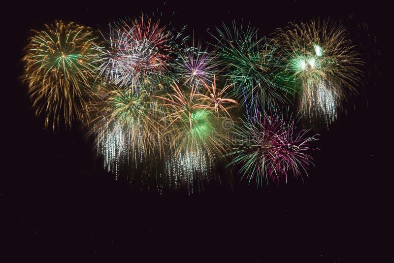 Beautiful celebration golden, green sparkling fireworks stock image