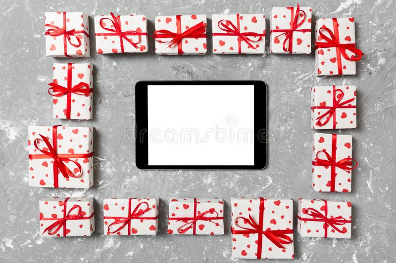 Beautiful celebratory valentine day or other holidays background. tablet with blank screen on the cement background. Digital royalty free stock photo