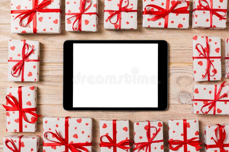 Beautiful celebratory valentine day or other holidays background. tablet with blank screen on the wooden background. Digital royalty free stock images