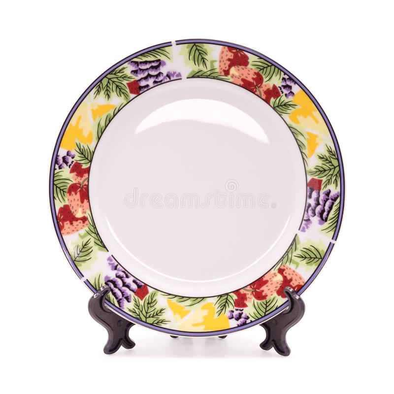 Beautiful ceramic dish and holder isolated on white background. Design plate in fruit pattern style.  Clipping path. Dish royalty free stock photography