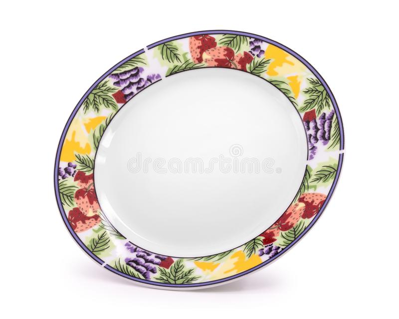 Beautiful ceramic dish isolated on white background. Design plate in fruit pattern style. Clipping path. Beautiful ceramic dish isolated on white background stock photos