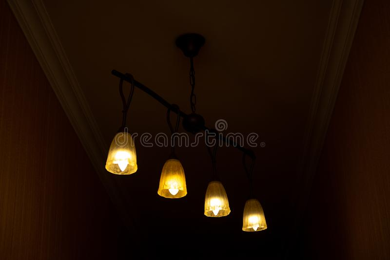 Beautiful Chandelier Backgrounds. Modern chandelier hanging under ceiling stock photography