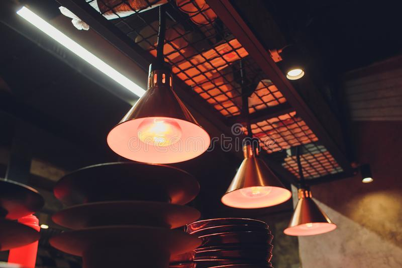 Beautiful chandelier. Modern chandelier hanging under ceiling. stock photo