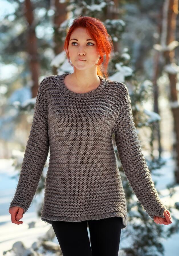 Free Beautiful Charming Girl With Red Hair In The Winter Park. Pensive, Dreamy, Loving Look. Cold Weather. Trees In The Snow Royalty Free Stock Photo - 171416985