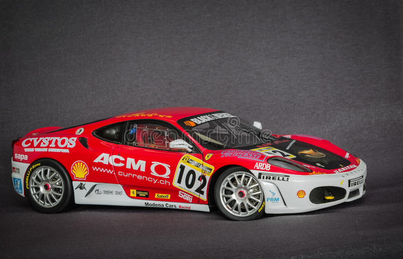 Beautiful charming view of Ferrari race sport miniature car model against dark grey background stock image