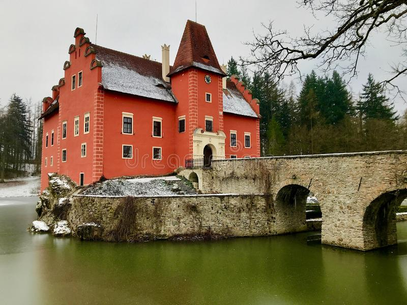 Beautiful chateau with a bridge and frozen moat during winter. In Cervena Lhota royalty free stock photo