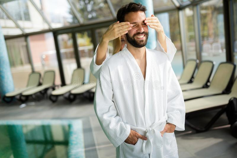 Beautiful cheerful couple relaxing in spa center. Together royalty free stock images