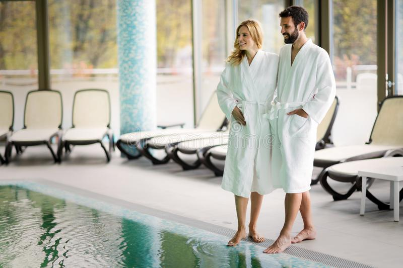 Beautiful cheerful couple relaxing in spa center. Together royalty free stock photography