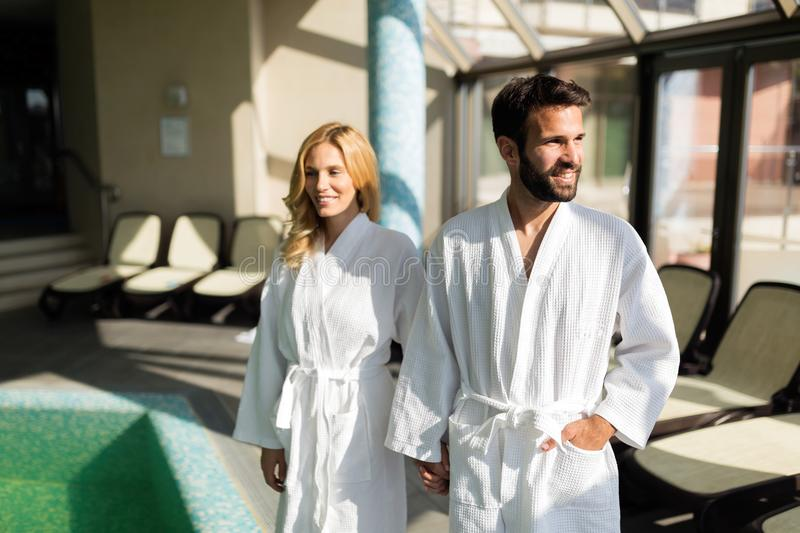 Beautiful cheerful couple relaxing in spa center. Together stock photo