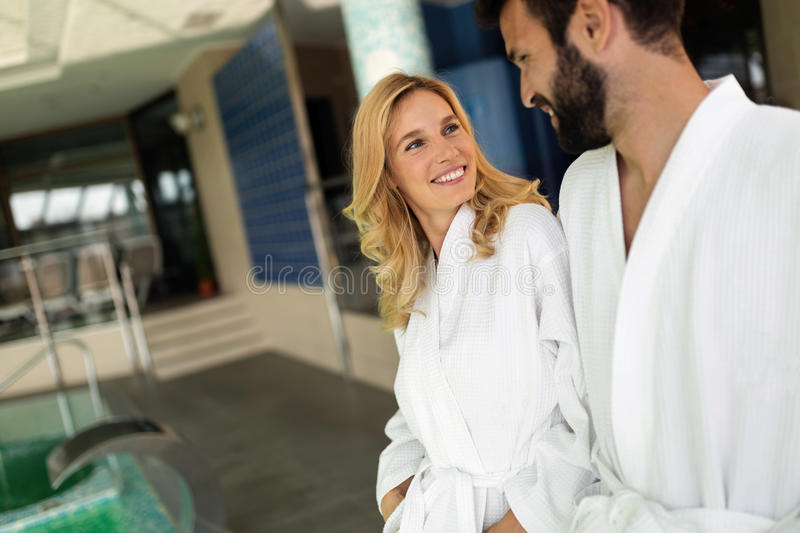 Beautiful cheerful couple relaxing in spa center. Together royalty free stock photo