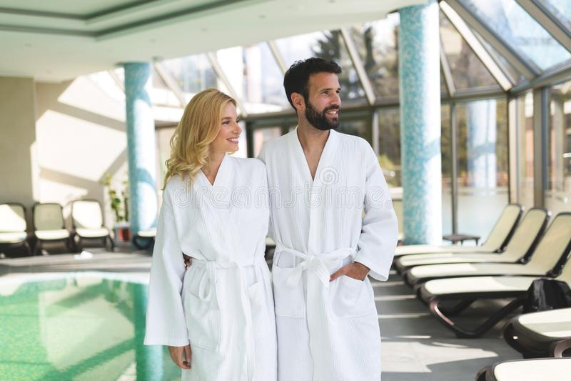 Beautiful cheerful couple relaxing in spa center. Together stock images