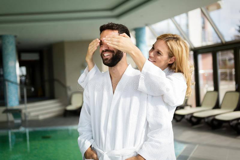 Beautiful cheerful couple relaxing in spa center. Together stock photography
